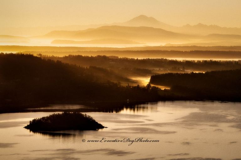 evocative photography of calgary alberta photographs a golden sunrise over the saanch inlet and mount baker from the malahat summit on the trans canada highway in beautiful british columbia on vancouver island
