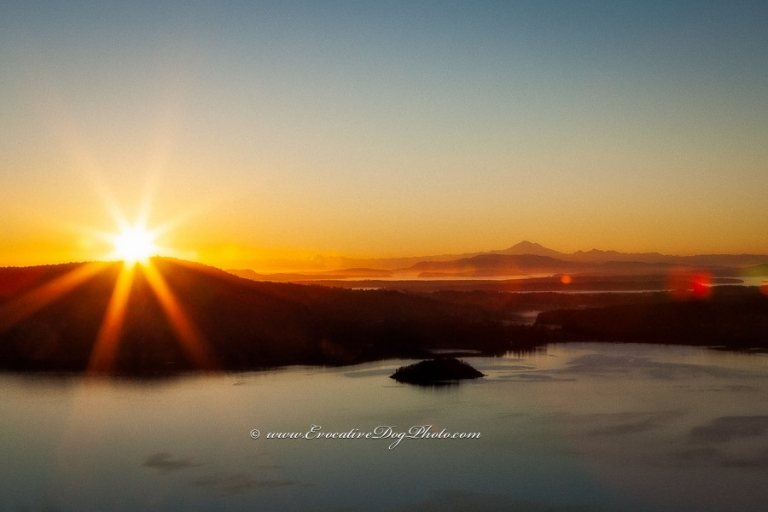 evocative photography of calgary alberta captures the sun rising over the saanch inlet from the malahat viewpoint on the trans canada highway in beautiful british columbia on vancouver island